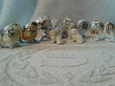 Lot of 8 Porcelain Pekingese Figurines 2 made by Orion, 5 Japan made, and Misc.