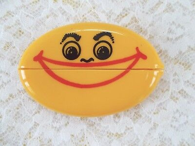 Vintage Soft Yellow Rubber Squeeze Coin Holder With Advertising