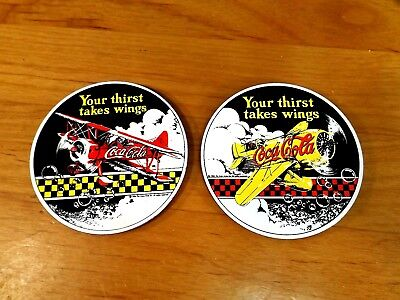 COCA-COLA PORCELAIN MAGNETS - SET of 2 - AIRPLANES - YOUR THIRST TAKES WING