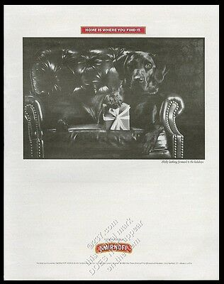 1991 rottweiler with Christmas present photo Smirnoff vodka print ad