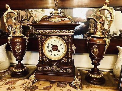 Antique Cased Ornate clock with matching ornamental jugs