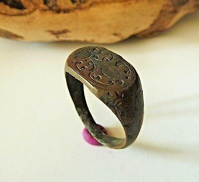 Post medieval bronze ring with pseudoheraldic image (743).
