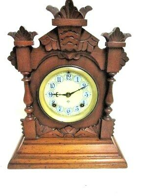 A Victorian Ansonia American Oak Chiming Mantel Clock