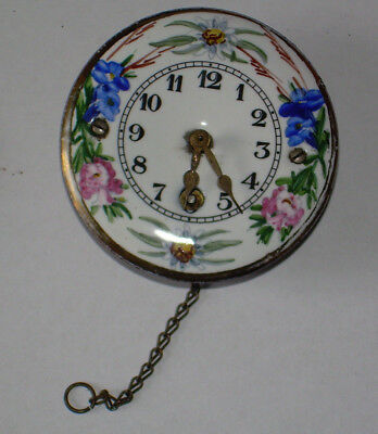 Vintage Wintermantle clock.Enamel Ceramic face 2.25 inch German.Hand painted Key
