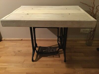 A hand built Singer sewing machine table