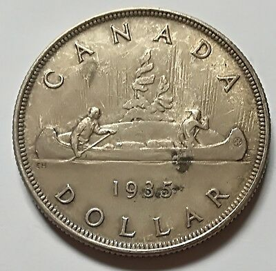 1935 Canada Silver One Dollar Coin. BETTER GRADE (ID = RJ712)