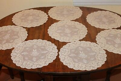 8 Antique placemats with coat of arms;armorial design with Cruce Salus 10 inches