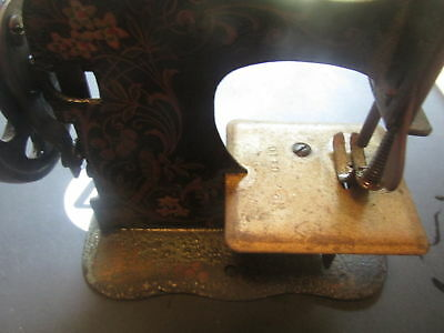 very early hand crank sewing machine miniture done in color scroll