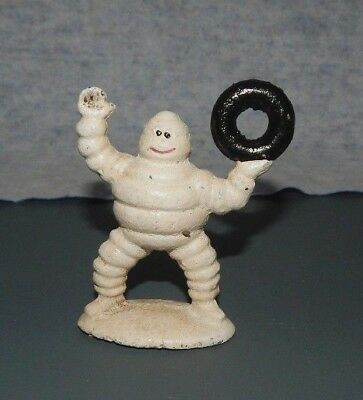 MICHELIN TIRE MAN FIGURINE HOLDING TIRE UP Cast Iron Advertising Paperweight