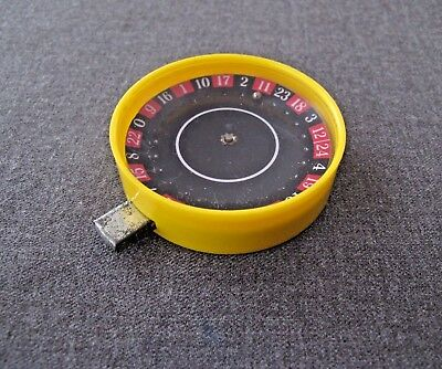 Vintage Tin & Yellow Plastic Push Button Spinning Roulette