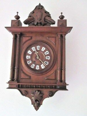 A Victorian Style Walnut Carved French Chiming Wall Clock