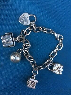 TIFFANY & CO. Sterling Silver Jewelry Pieces - Bracelet and charms