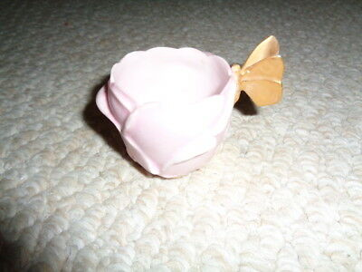 Pink demitasse rose cup gold butterfly handle English layered petals exterior