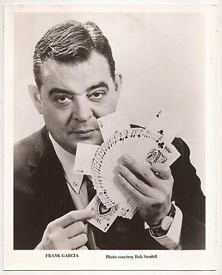 PROMOTIONAL PHOTO OF FRANK GARCIA with four aces card fan.
