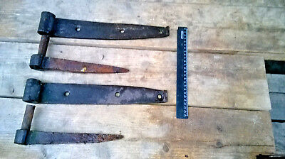 A pair of old village door hinges