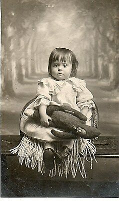 Pretty Little Girl Holding her Doll & sat on a Childs Chair:See Scans
