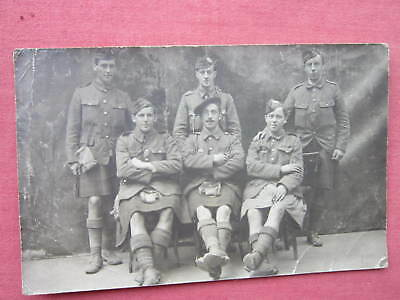 WW 1 MILITARY GROUP, 6 KILTED SCOTTISH SOLDIERS POSING vintage B&W R.P. postcard