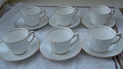 Six Royal Kendal China Cups And Saucers  White With A Gold Coloured Trim