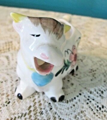 Male Cow Creamer With Flower On Side And Chips
