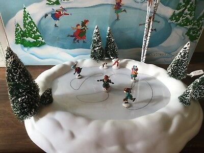 Dept 56 Ice Skating Pond, Accessory, 4 Skaters,1 Dog, 1 Snowman,trees.