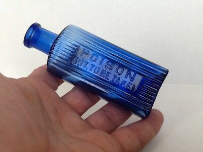 Antique Cobalt Blue Embossed Poison & Not To Be Taken Rectangular Poison Bottle.