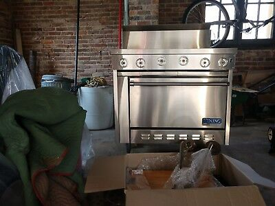 commercial, gas viking stove. Stainless steel, 4 burner + griddle in middle.