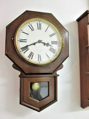 A Vintage Drop Down Chiming Wall Clock With Octagonal Head