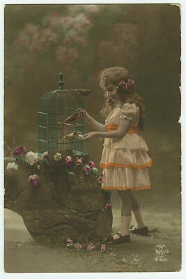 1910s child Children Darling GIRL w/ BIRD IN CAGE birdcage tinted photo postcard