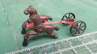Cast iron & tin front harness section for old toy horse drawn fire engine.