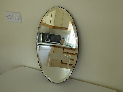 Vintage bevelled frameless oval wall mirror with original chain