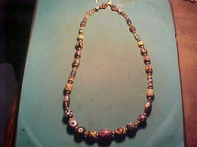 SPECIAL OFFER String of suberb  Islamic glass  beads circa 12th-18th century AD.