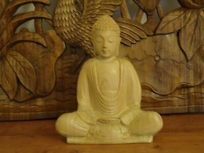 Bali buddha wood carving