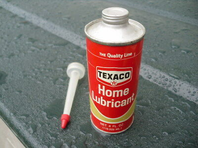 Metal Texaco metal home lubricant can never opened with unused spout