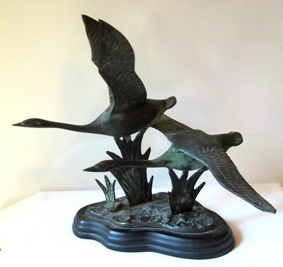 Metal Canada geese sculpture showing two birds in flight