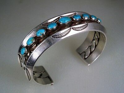 OLD NAVAJO DUAL CARINATED STERLING SILVER & 9 TURQUOISE ROW BRACELET Toby Turpin