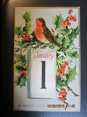vintage NEW YEAR postcard JANUARY 1 RED ROBIN HOLLY TUCK used