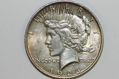 About Uncirculated 1923 P Nicely Toned 90% Silver Peace Dollar (PDX1148)