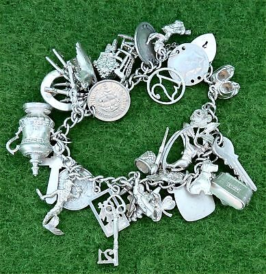 VINTAGE 1980s SILVER CHARM BRACELET FEATURING 27 DIFFERENT SILVER CHARMS 1.94ozt