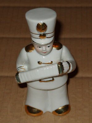 Charming China figure of Concertina Player in Military Uniform