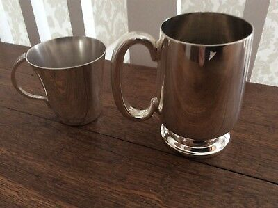 Two vintage silver plated tankards