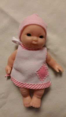 TINY MINI BABY DOLL SLEEPING IN CRADLE WITH PINK BUNTING ON   new
