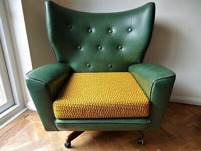 Pair of Vintage original retro Mid Century Green vinyl swivel - tilt  armchairs