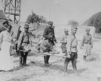 Wounded soldier on strecher carried by French soldiers World War I 8x10 Photo