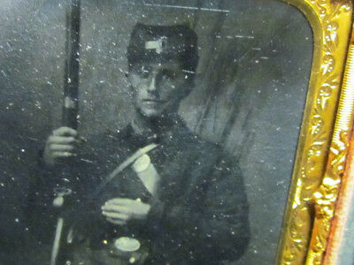 Civil War soldier holding his rifle tintype photograph