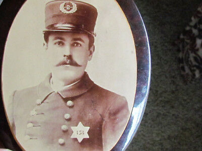 unusual early 1900's police officer mounted on tin stand up dresser frame