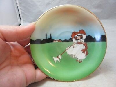 Vintage child's hand painted saucer. Bonnet girl & dog