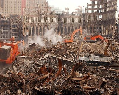 FIRES BURN IN THE RUBBLE OF THE WORLD TRADE CENTER 091411-8X10 PHOTO EP-725