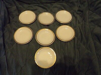 7 Vintage Butter Pats, White With Gold Rim
