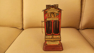 c 1900 French Lithographed Tin Toy Bank Candy Dispenser w orig key & string VG