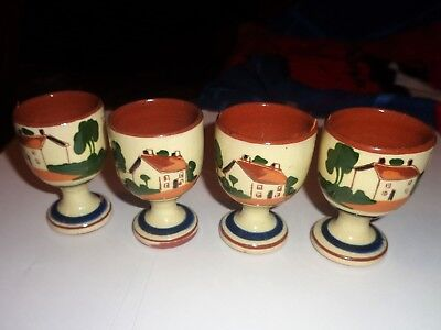 A Set Of 4 Watcombe Motto Ware Egg Cups.